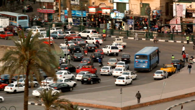 cu pan traffic around tahrir square/ cairo/ egypt - egypt stock videos & royalty-free footage