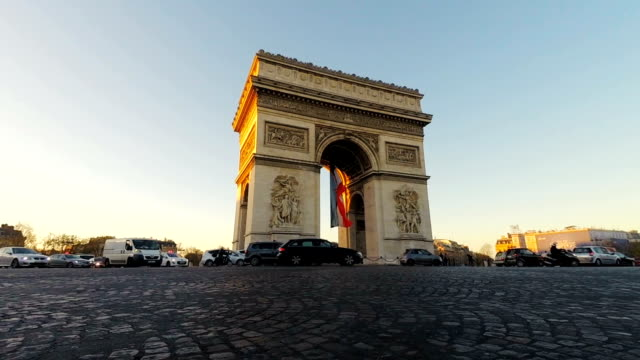 traffic around the arc de triomphe paris france at sunset - avenue des champs elysees stock videos & royalty-free footage