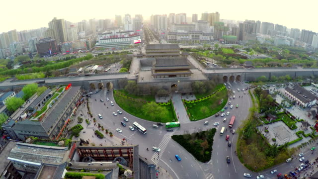 WS AERIAL traffic around west gates of citywall at sunset,Xi'an,China.