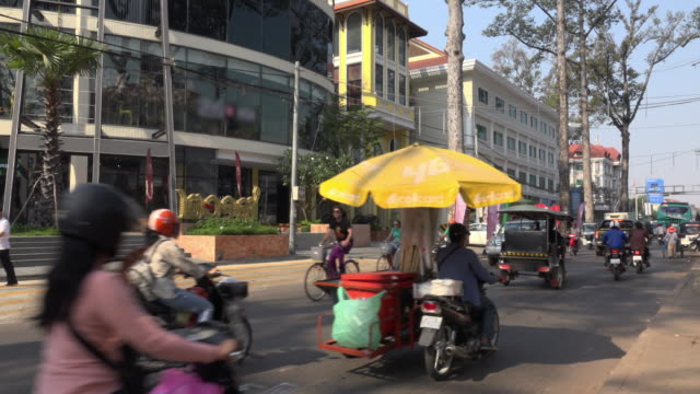 traffic at airport road in the new quarter in siem reap - quarter stock-videos und b-roll-filmmaterial