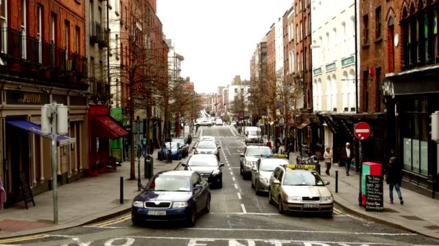traffic at an intersection in dublin ireland - dublin ireland stock videos and b-roll footage