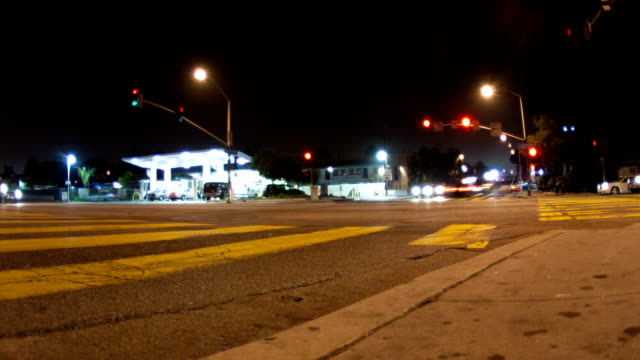 traffic at an intersection - time lapse - traffic light stock videos & royalty-free footage
