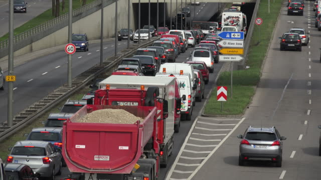traffic at georg-brauchle-ring near olympic park, munich, bavaria, germany - dumper truck stock videos & royalty-free footage