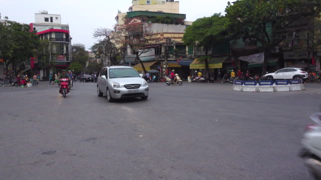 traffic at hanoi vietnam. motorbikes and cars at roundabout - north vietnam stock videos & royalty-free footage