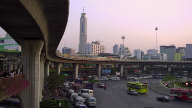 WS HA Traffic at intersection with overpass and cityscape in background, Bangkok, Ayuthaya, Thailand
