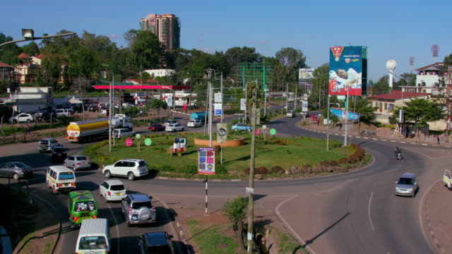 traffic at langata rd & ole sangale rd roundabout nairobi  kenya  africa - banner sign stock videos & royalty-free footage