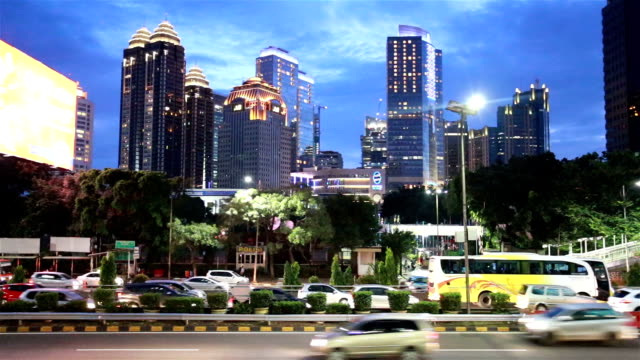 traffic at night in jakarta financial district in indonesia capital city. - jakarta stock videos & royalty-free footage