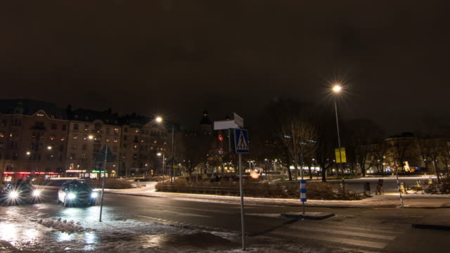 traffic at night in stockholm, sweden - electric lamp stock videos and b-roll footage