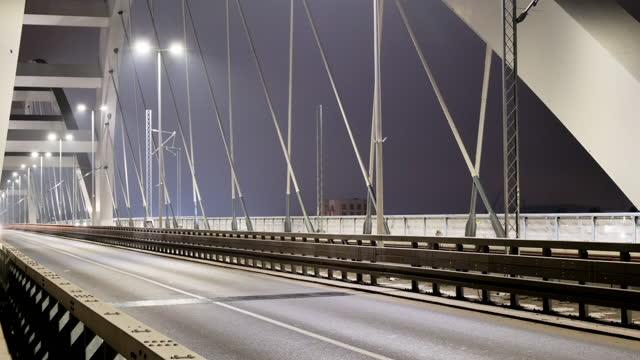 traffic at night time lapse. traffic over the modern suspension bridge - suspension bridge stock videos & royalty-free footage