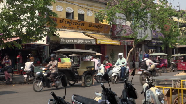 traffic at old market area in downtown siem reap - cambodia stock videos and b-roll footage