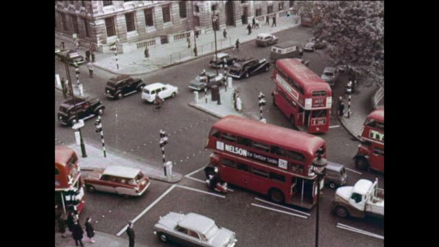 vídeos de stock e filmes b-roll de montage traffic at piccadilly circus moves without accidents / uk - 1964
