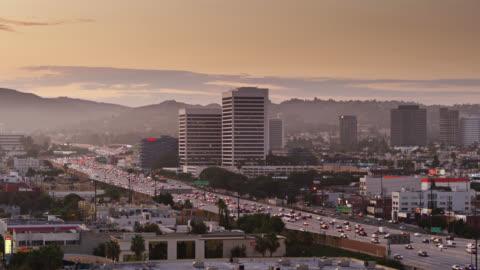 i-405 traffic at sunset in la - aerial - westwood neighborhood los angeles stock videos & royalty-free footage