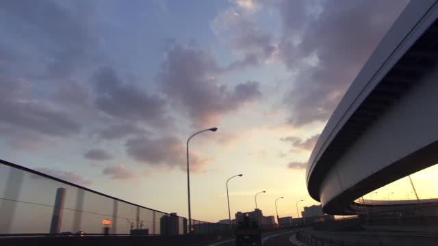 traffic at sunset pov - artbeats bildbanksvideor och videomaterial från bakom kulisserna