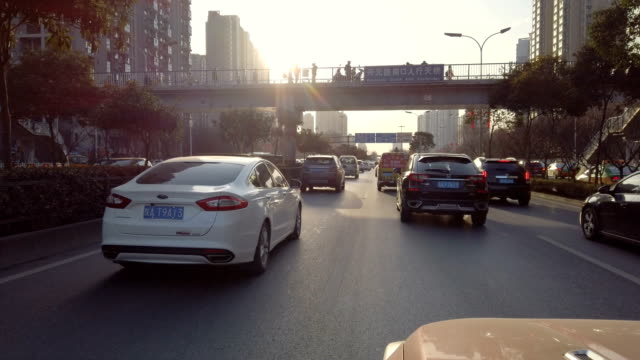 pov traffic at sunset,xi'an,shaanxi,china - 視点点の映像素材/bロール