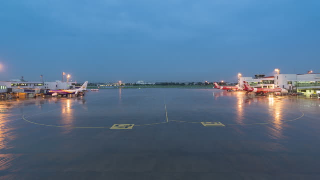 Traffic at the airport runway dusk to night time lapse