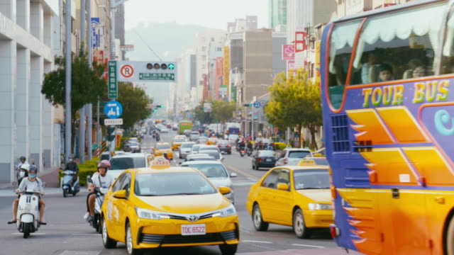 traffic at the road intersection in kaohsiung, taiwan - taiwan stock videos & royalty-free footage