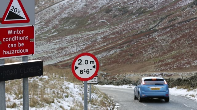 traffic at the summit of kirkstone pass in the lake district in winter, uk. - ice stock videos & royalty-free footage