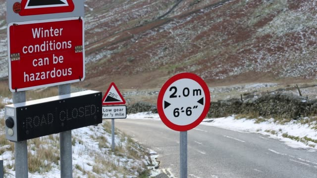 traffic at the summit of kirkstone pass in the lake district in winter uk - narrow stock videos & royalty-free footage