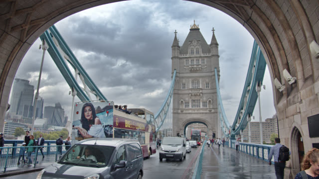 traffic at tower bridge. london - london bridge england stock videos & royalty-free footage