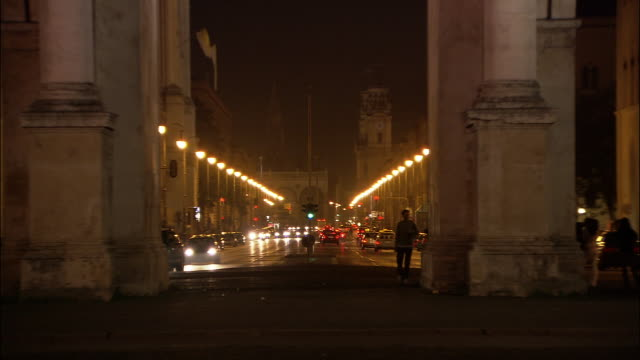 ZO, WS traffic at Victory gate Siegestor at night, Munich, Bavaria, Germany