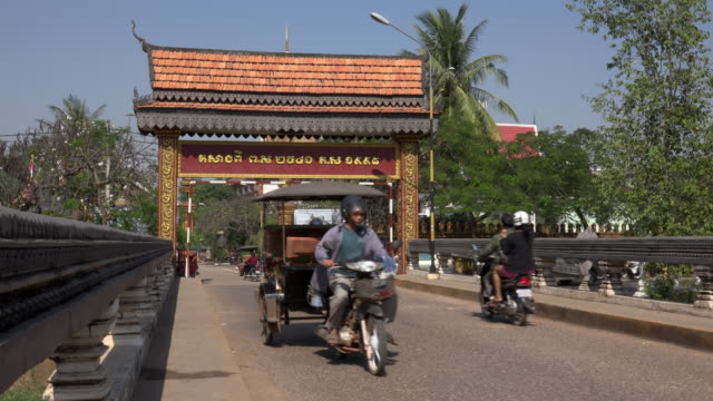 Traffic at Wat Preah Prom Rath temple in Siem Reap