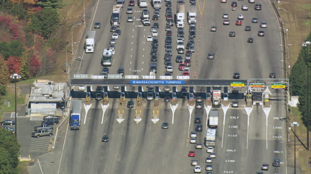 AERIAL Traffic backed up at multi-lane Massachusetts Turnpike toll booth / United States
