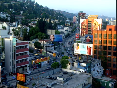 traffic billboards and buildings on sunset strip in early evening light hollywood - hollywood california stock videos & royalty-free footage