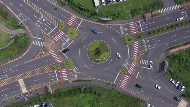 traffic circle in andeok county / seogwipo-si, jeju-do, south korea - crossroad stock videos & royalty-free footage