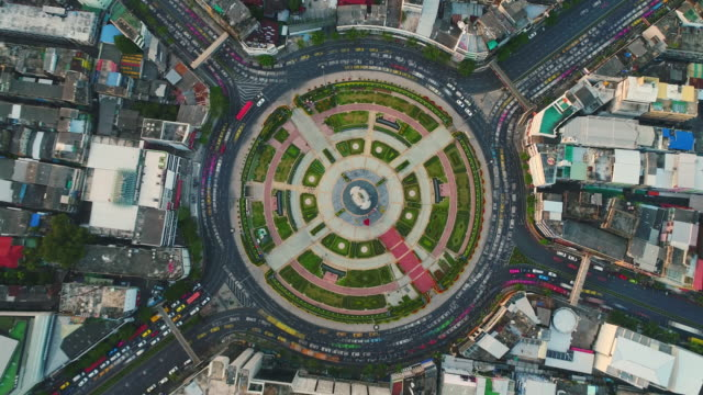 traffic circle roundabout aerial view in bangkok - roundabout stock videos and b-roll footage
