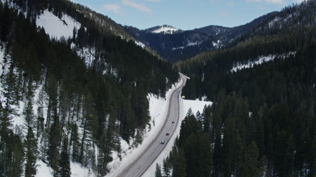 traffic climbing up teton pass from idaho into wyoming - aerial - wyoming stock videos & royalty-free footage