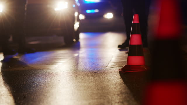 traffic cone on the road. place of an accident. transport. road traffic at night. sign - police vehicle lighting stock videos & royalty-free footage