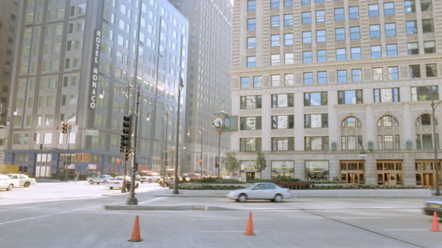 traffic cones direct the flow of traffic on a chicago street. - traffic cone stock videos & royalty-free footage