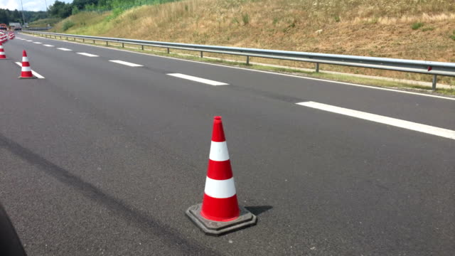 traffic cones on highway - traffic cone stock videos & royalty-free footage