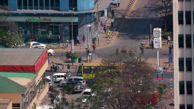 traffic congestion on street nairobi  kenya  africa - western script stock videos & royalty-free footage