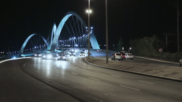 ms traffic crosses ponte juscelino kubitschek bridge at night / brasilia, brazil - juscelino kubitschek bridge stock videos & royalty-free footage