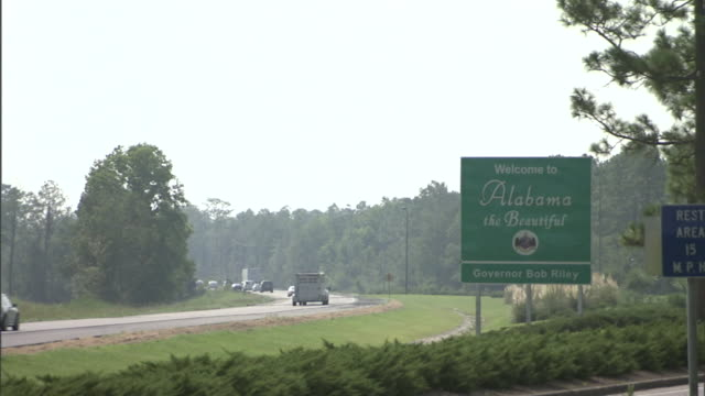 traffic crosses the alabama state line. - alabama us state stock videos & royalty-free footage