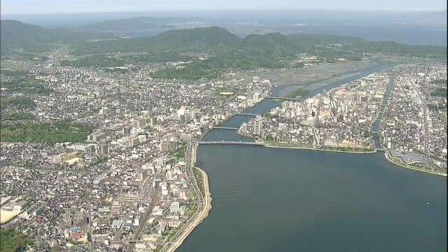 traffic crosses the shinjikoohashi bridge spanning the ohashi river in matsue city, japan. - shimane prefecture stock videos & royalty-free footage