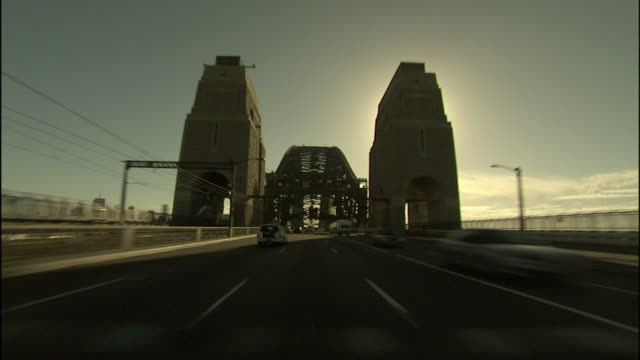 traffic crosses the sydney harbor bridge in the late afternoon. - car point of view stock videos & royalty-free footage