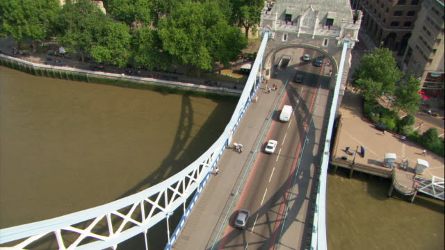 traffic crosses the tower bridge in london. - tower of london stock videos & royalty-free footage
