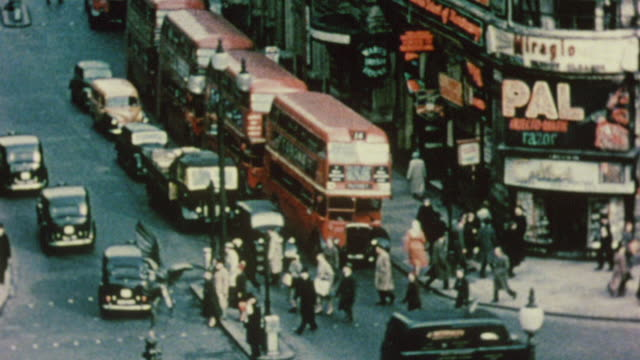 1956 ha traffic crossing an intersection / london, england - colour image stock videos & royalty-free footage