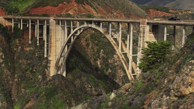traffic crossing bixby creek bridge in big sur - aerial - bixby creek bridge stock videos & royalty-free footage