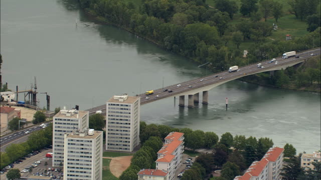 aerial ws traffic crossing bridge over rhone river / givors, rhone, france - rhone river stock videos & royalty-free footage