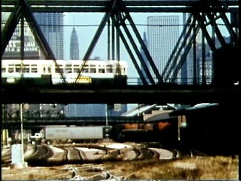 1963 montage ws traffic crossing bridge with skyline in background / chicago, united states / audio - chicago illinois stock-videos und b-roll-filmmaterial