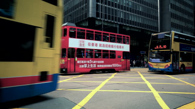 traffic crossing des veoux road central on hong kong island - hong kong island stock videos & royalty-free footage