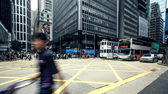 traffic crossing des veoux road central on hong kong island - central district hong kong stock videos & royalty-free footage