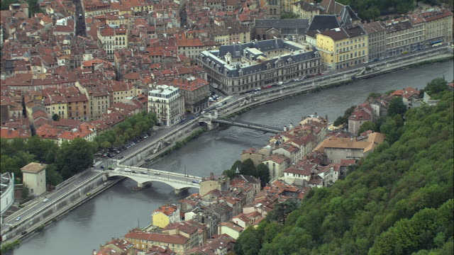 aerial ws traffic crossing pont saint laurent over isere river near palais de justice with musee de grenoble in foreground / grenoble, france - grenoble stock-videos und b-roll-filmmaterial