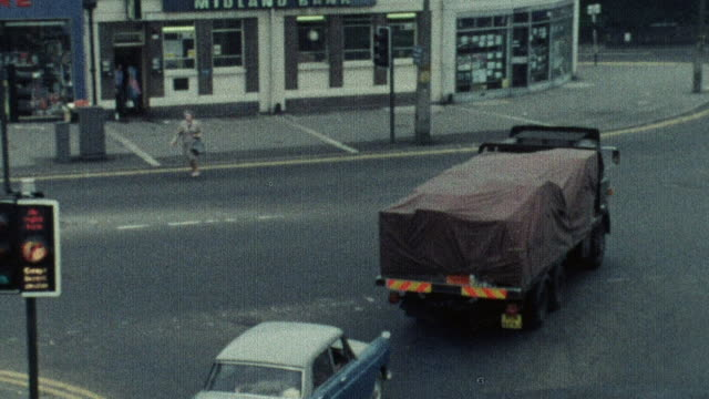1974 montage traffic crossing through major intersection once the light changes / southampton, hampshire, england - hampshire england stock videos and b-roll footage