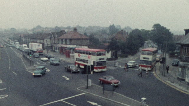 1974 montage traffic crossing through major intersection once the light changes / southampton, hampshire, england - southampton england stock videos & royalty-free footage