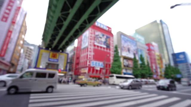 traffic crowd overpass the street ,akihabara district, tokyo, japan. - akihabara station stock videos and b-roll footage