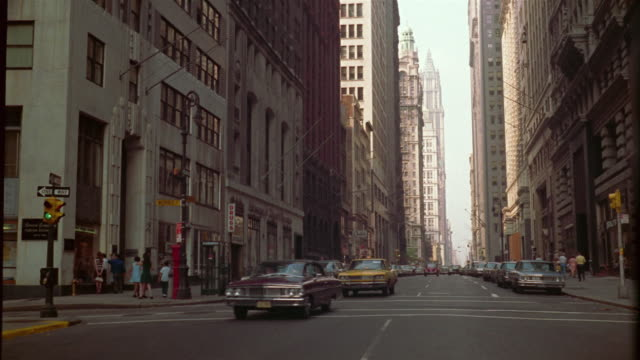 vídeos de stock e filmes b-roll de 1969 ws traffic down broadway, corner of morris st. financial district, new york city, new york, usa - 1969